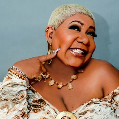 The 62-year old daughter of father (?) and mother(?) Luenell in 2021 photo. Luenell earned a  million dollar salary - leaving the net worth at  million in 2021